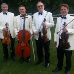Male String Quartet dressed in White Tuxedos
