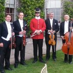 String Quartet dressed in evening tail suits